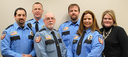 Left to right: Officer Jason Krumheuer, Assistant Chief John Sandgren, Chief Derek Lee, Officer Brian Stenholm, Officer Michelle Jensen, Admin Assistant Nanette Serbus.
